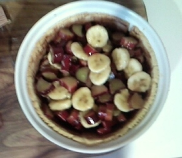 Banana and Rhubarb Pie ingredients loaded into crust